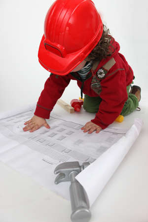 hat project: Young child pretending to be a construction worker