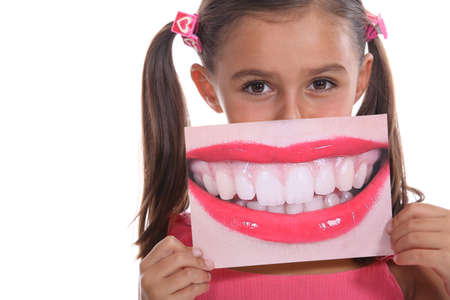 Little girl holding photo of mouth Stock Photo - 18816085