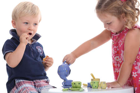 two children playing at tea parties photo