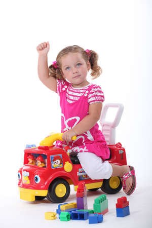 adapted: Girl on a toy car