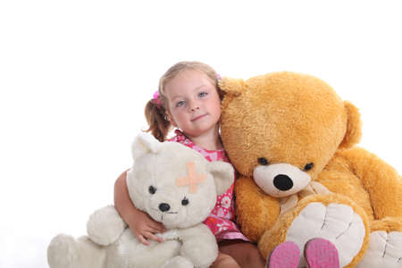 cuddly: Little girl sat with cuddly toys