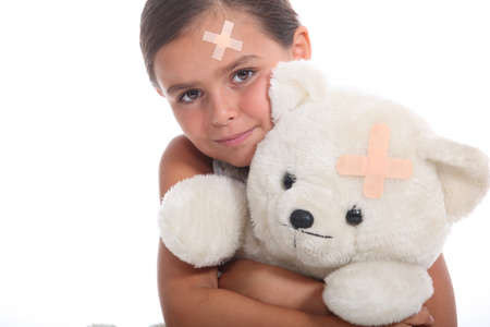 Girl and teddy with a plaster photo