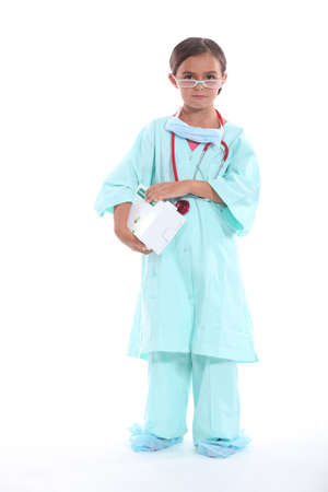 Little girl dressed in nurses uniform photo