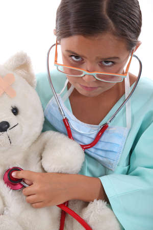 Little girl dressed in nurses outfit photo
