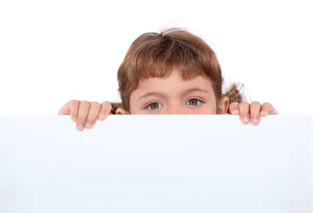 hands behind head: little girl hiding behind a board