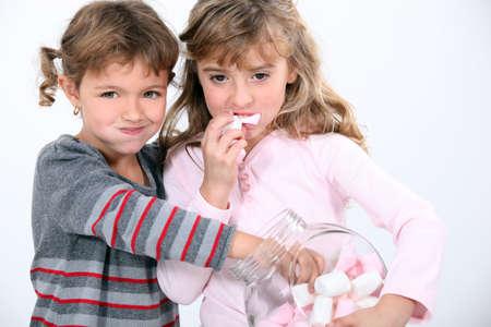 Girls eating marshmallows