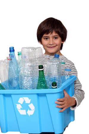 recycling bottles: Little boy recycling plastic bottles Stock Photo