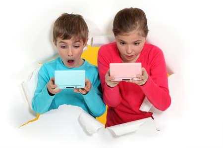 computer games: Children playing handheld computer games