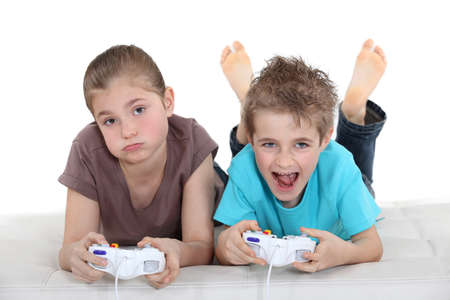 kids playing video games: Two kids playing video games
