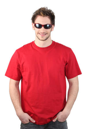 unconcerned: Man dressed in a red t-shirt and wearing sunglasses Stock Photo