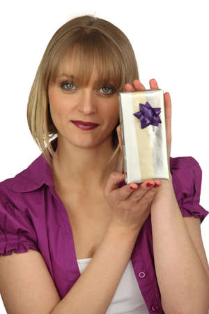 Woman holding gift Stock Photo - 18816430