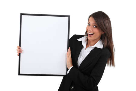 suited up: Delighted woman holding a black framed board left blank for your image Stock Photo