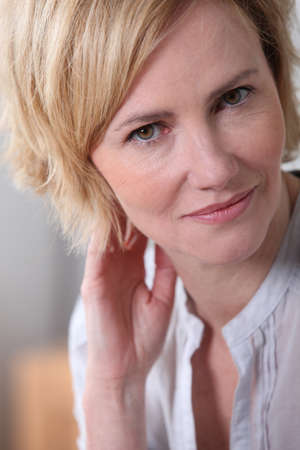 shy woman: Woman with shy expression. Stock Photo