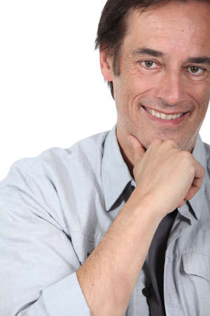 Man smiling holding chin. Stock Photo - 18817489