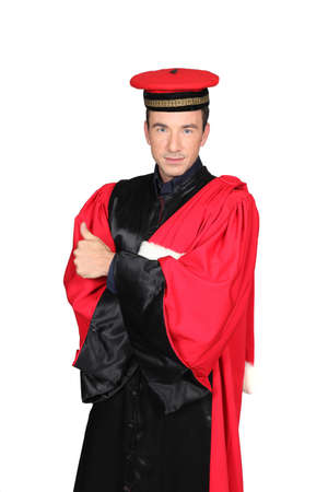 ceremonial clothing: Man in red and black robes and hat Stock Photo