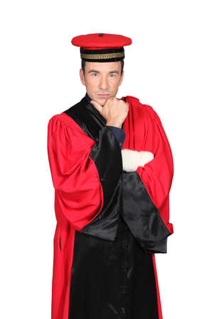 aplomb: Magistrate wearing red dress Stock Photo