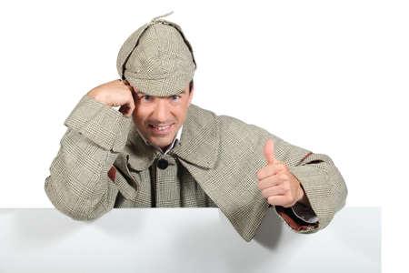 kepi: Man dressed as old fashioned detective