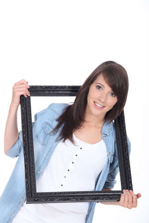 look pleased: woman hanging frame