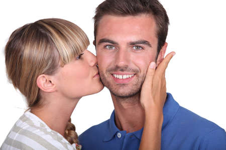 thanking: Young woman kissing a mans cheek Stock Photo