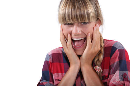 mouth open: Young woman with surprised look on face Stock Photo