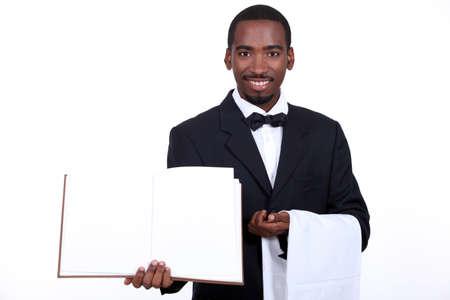black waiter showing menu Stock Photo - 18815313