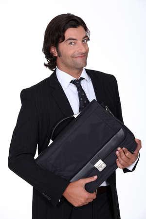 Happy executive holding case Stock Photo - 18948448
