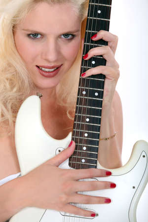 sexy guitar: Blond woman holding electric guitar