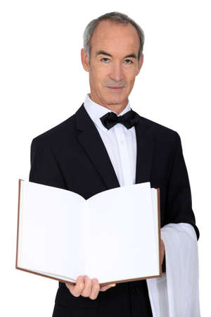 grey haired: Grey haired waiter with menu