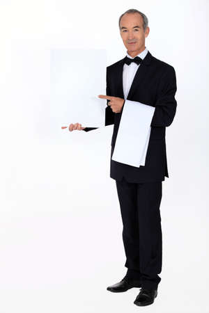 Waiter with a blank menu photo