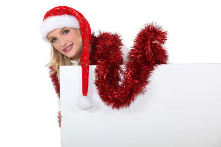 Festive woman stood with blank poster photo