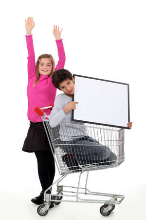 schooltime: Two kids with trolley