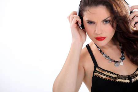 scowl: Wild woman listening to music