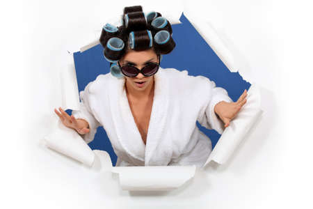 implausible: Woman in a bathrobe with her hair in rollers