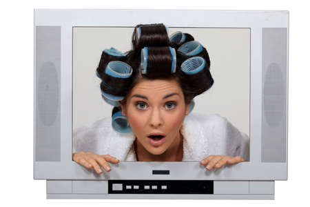 big screen tv: woman in tv set with hair curlers Stock Photo