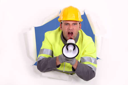 dissuade: road worker yelling in a megaphone