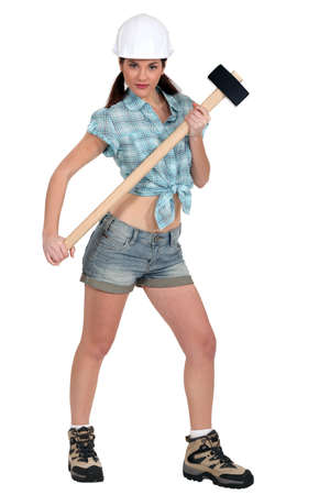 Portrait of sexy woman with hammer Stock Photo
