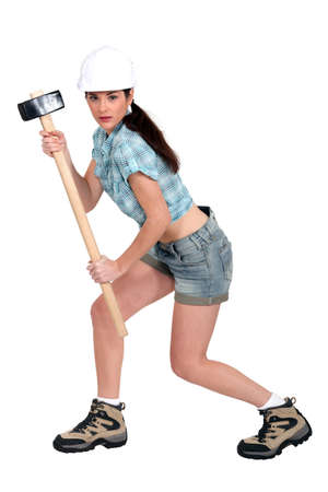 sordid: Female builder with hammer