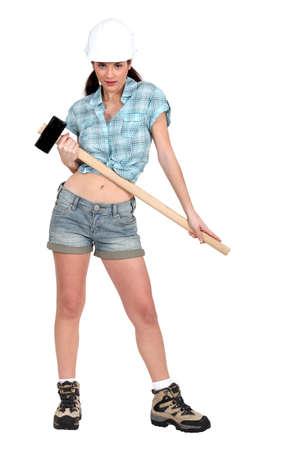 servicewoman: Woman holding sledge-hammer