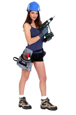 Sexy woman holding an electric screwdriver Stock Photo - 18944803