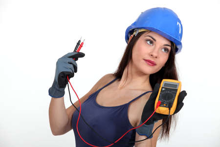 multimeter: Sexy tradeswoman holding a multimeter Stock Photo