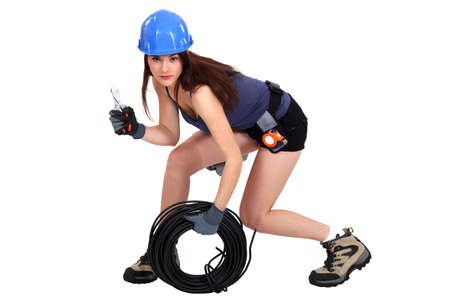 workwoman: A prowling electrician Stock Photo