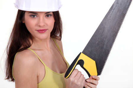 handsaw: Young woman with a saw Stock Photo