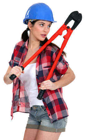 sexy construction worker: Woman holding bolt cutters