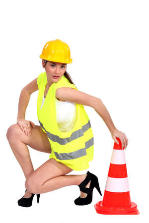 sexy woman holding a traffic cone photo