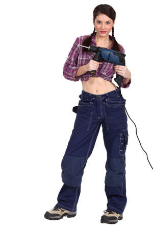 knotted: Woman with a powerdrill Stock Photo