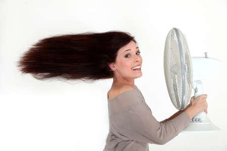 electric fan: Woman with an electric fan