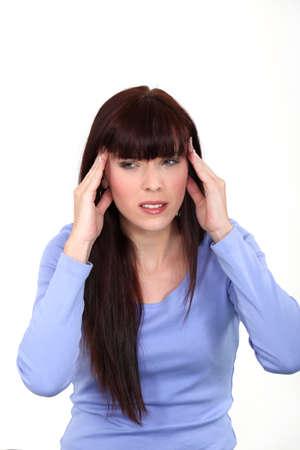 throbbing: Woman suffering from a throbbing headache