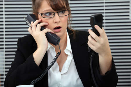 secretary overwhelmed by phone calls Stock Photo - 18948504