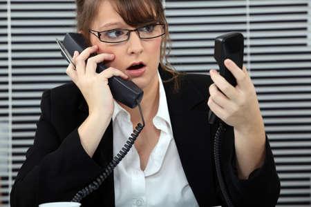 secretary overwhelmed by phone calls Stock Photo - 18948504