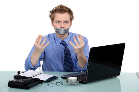 voiceless: Office worker with his mouth taped shut Stock Photo